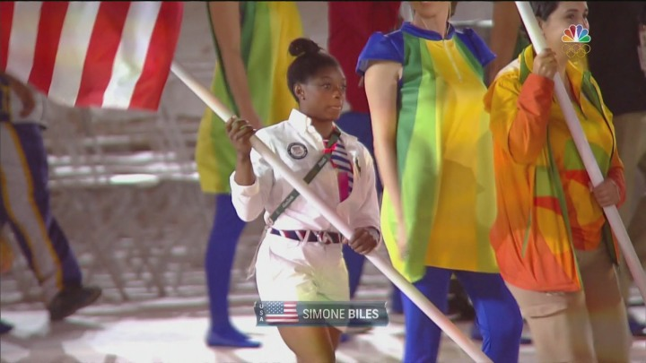 U.S. Biles carries in the flag at the Closing Ceremony